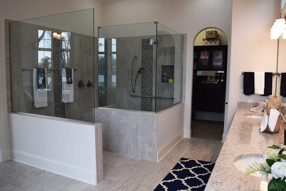 Walk-in granite shower in a master bathroom of one of Waterfront of West Clay's custom home in Carmel, IN