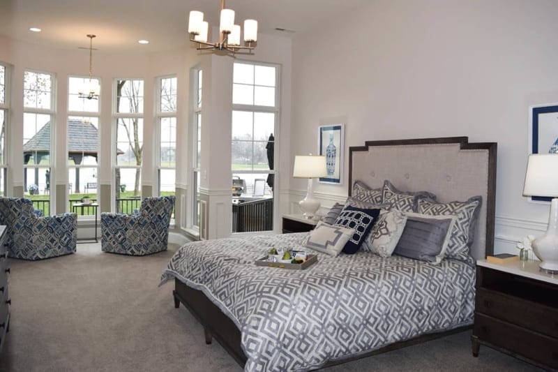 master bed with plush headboard in the master bedroom of one of Waterfront of West Clay's custom homes in Carmel