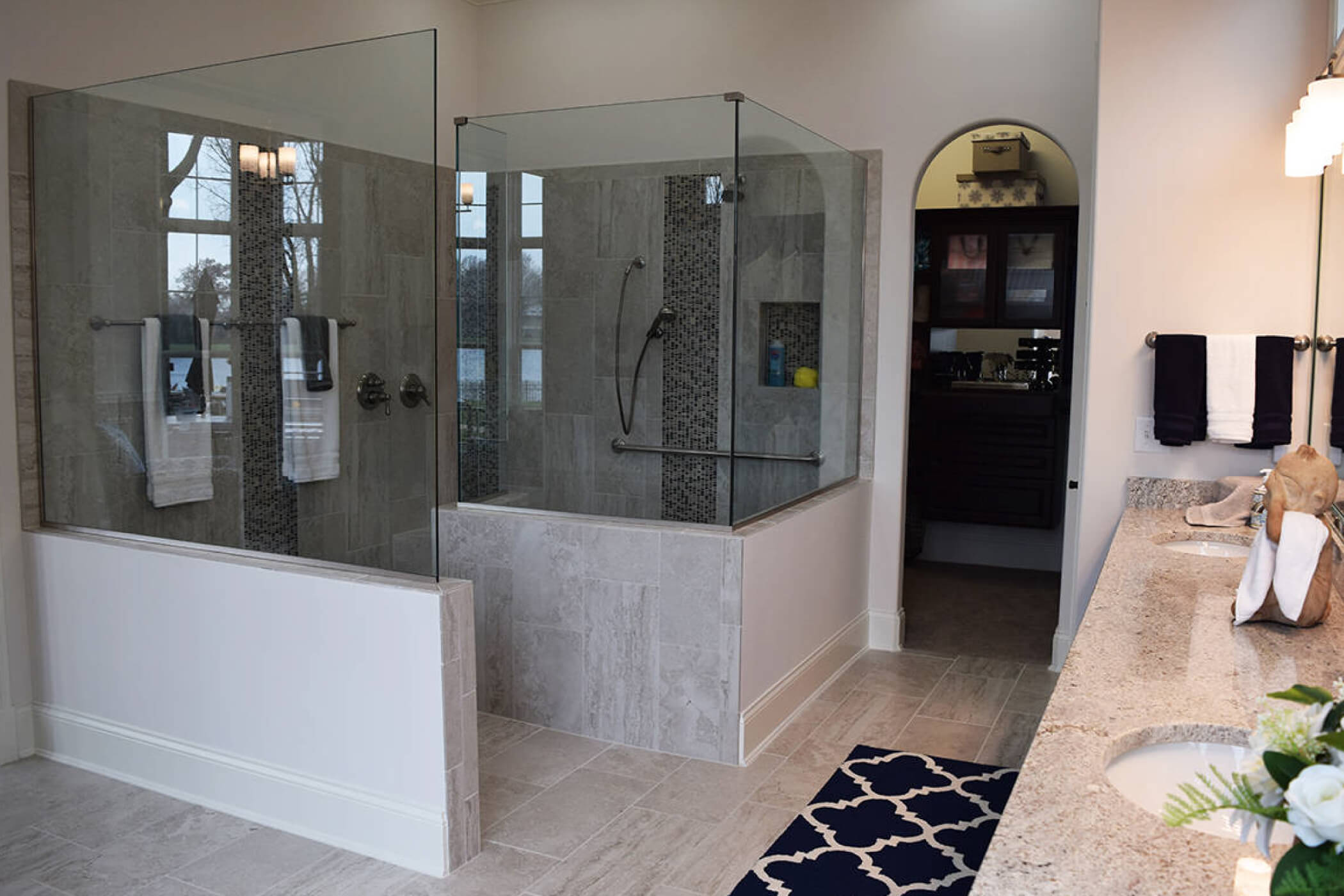 Walk-in granite shower in a master bathroom of one of Waterfront of West Clay's custom homes in Carmel, IN