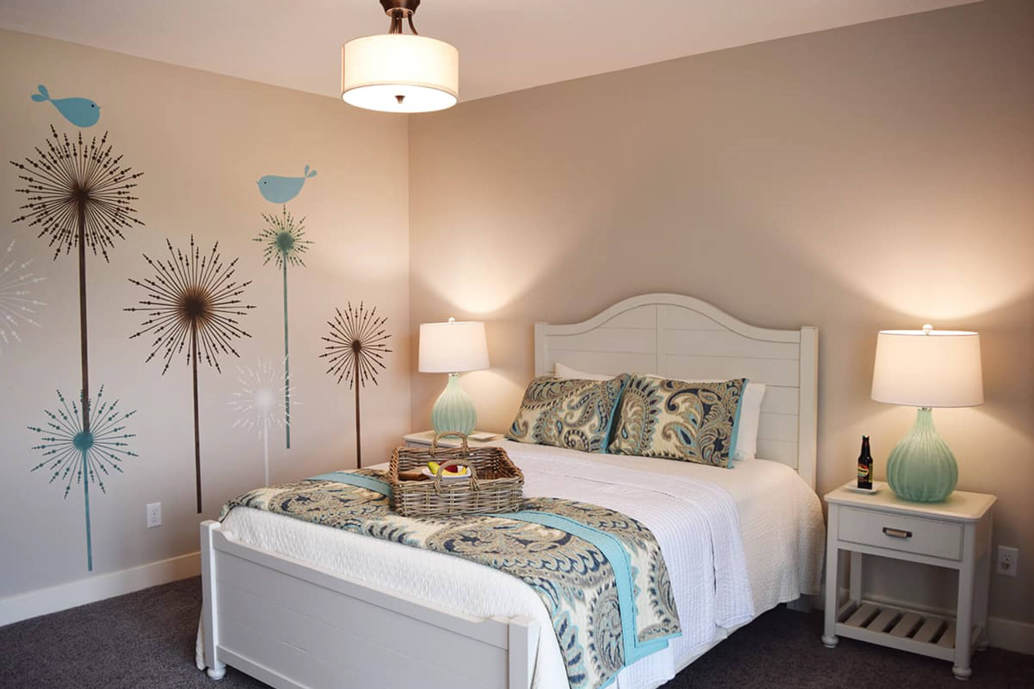 Full bed with white wood headboard in the bedroom of one of Waterfront of West Clay's custom homes