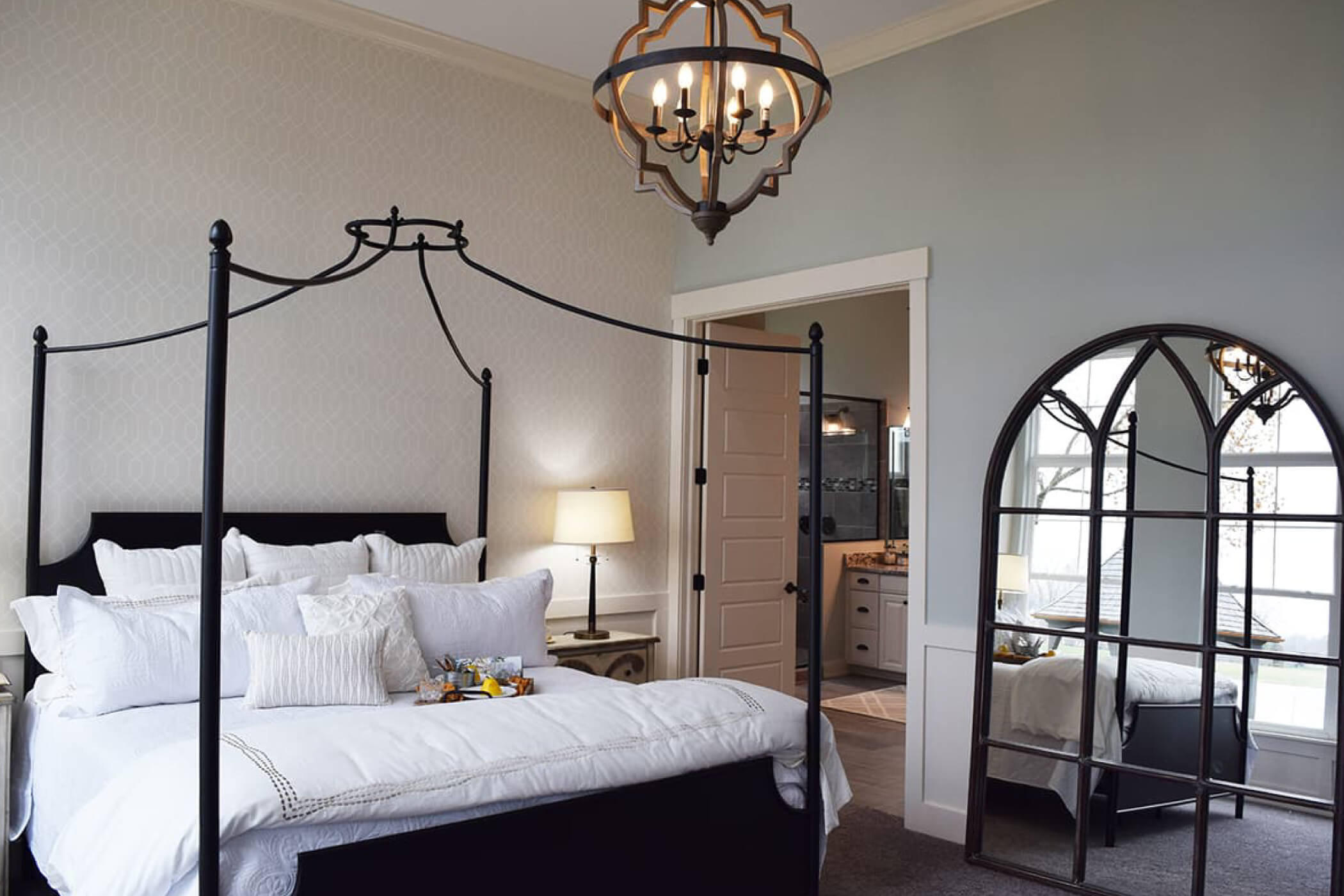 master bed with white bedding in the master bedroom of one of Waterfront of West Clay's custom homes in Carmel