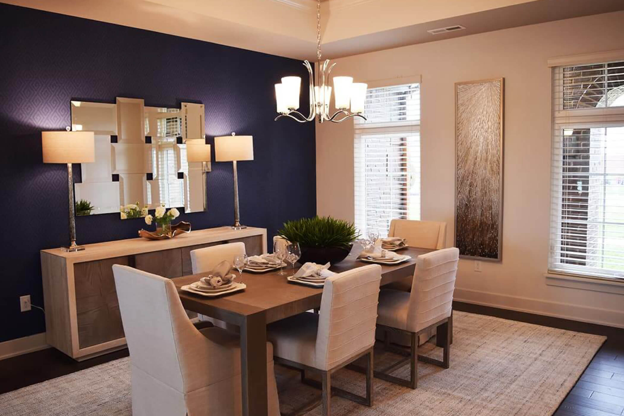 6 chair wood dining room table angled in the dining room of one of Waterfront of West Clay's custom homes