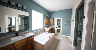 Custom Bathroom with oil rubbed bronze faucet, granite countertops